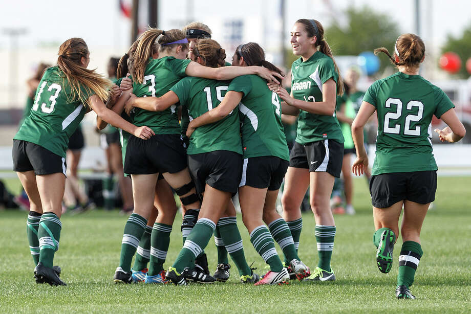 The Reagan Lady Rattlers congratulate Nikki Popa (3) after her first half goal to open the scoring during their 2-1 overtime victory over Brandeis in their Class 5A second round playoff game. Photo: MARVIN PFEIFFER, Marvin Pfeiffer / Prime Time New / Prime Time Newspapers 2013