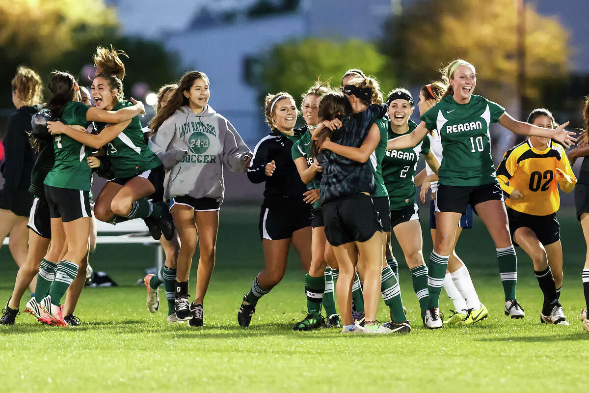 The Reagan Lady Rattlers celebrate their 2-1 overtime victory over Brandeis in their Class 5A second round playoff game.