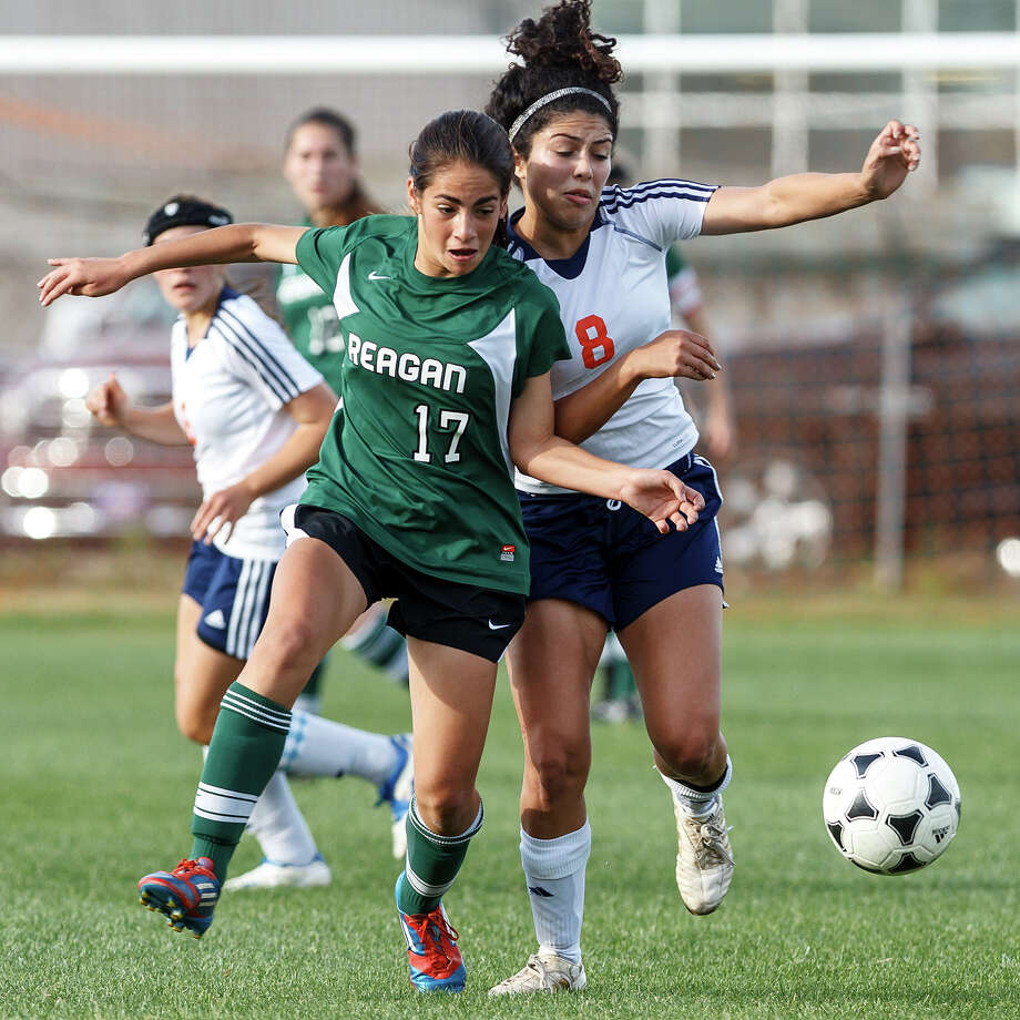 Reagan's Gabriela Galan (left) fights for the ball with Braneis's Mikaela Noriega during the first half of  their Class 5A second round playoff game. Photo: MARVIN PFEIFFER, Marvin Pfeiffer / Prime Time New / Prime Time Newspapers 2013