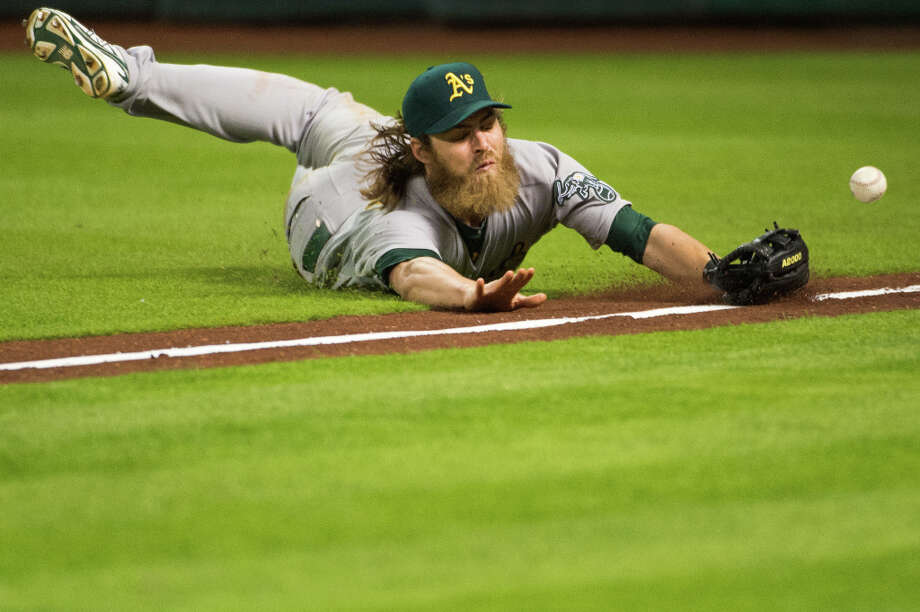 Oakland right fielder Josh Reddick can\'t make a diving catch on a ball off the bat of Matt Dominguez during the ninth. Photo: Smiley N. Pool, Houston Chronicle / © 2013  Smiley N. Pool