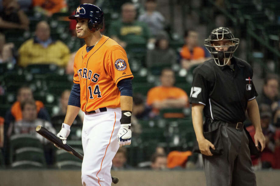 Astros pinch hitter J.D. Martinez walks back to the dugout after striking during the eighth inning. Photo: Smiley N. Pool, Houston Chronicle / © 2013  Smiley N. Pool