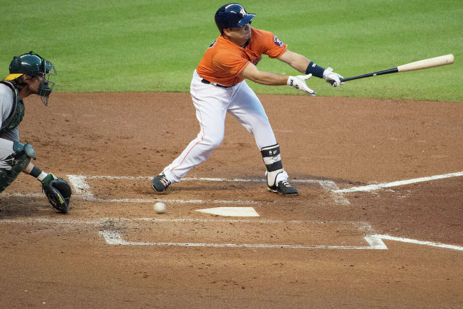 Jose Altuve chases a pitch in the dirt as he strikes out in the first.  The Astros fanned 13 times against the AÕs. Photo: Smiley N. Pool, Houston Chronicle / © 2013  Smiley N. Pool