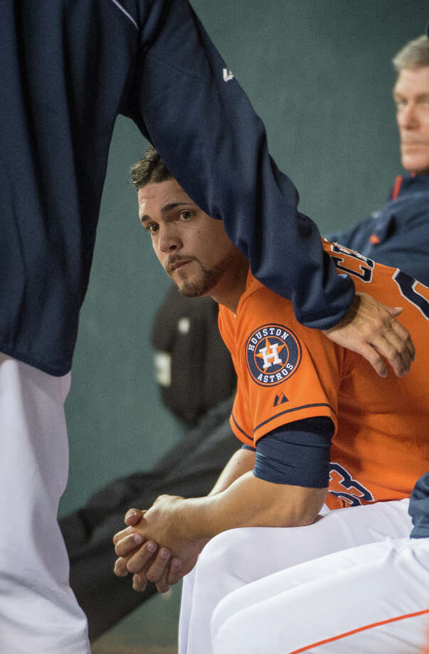 Astros relief pitcher Xavier Cedeno is consoled in the dugout after failing to retire a batter during the fifth. Cedeno gave up six runs in the inning. Photo: Smiley N. Pool, Houston Chronicle / © 2013  Smiley N. Pool