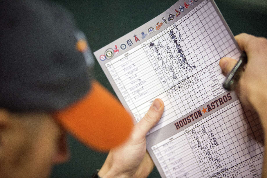 A fan\'s scorebook shows the damage done by the A\'s during the fifth inning.  More than 40 minutes ran by and seven runs were recorded in the inning. Photo: Smiley N. Pool, Houston Chronicle / © 2013  Smiley N. Pool