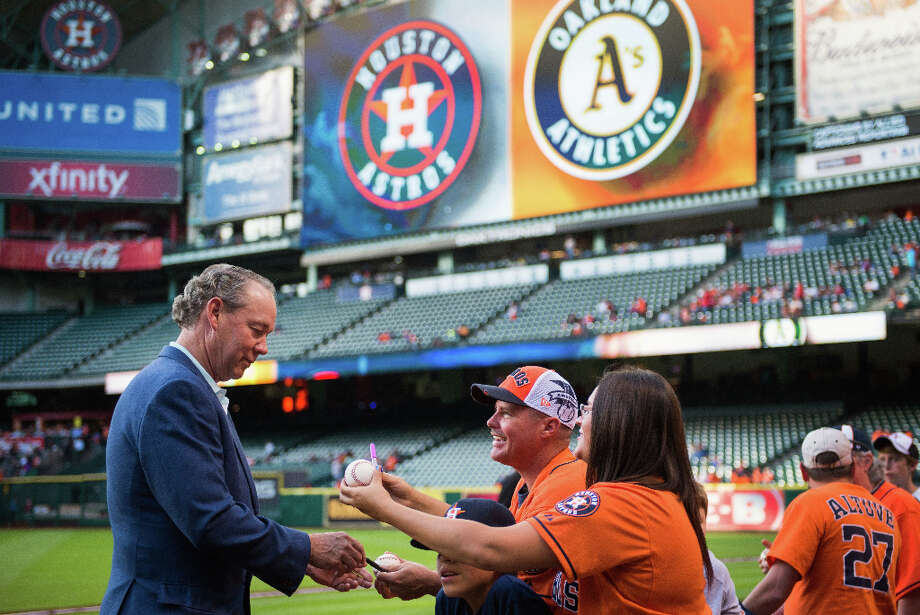 Astros owner Jim Crane signs autographs for fans before the game. Photo: Smiley N. Pool, Houston Chronicle / © 2013  Smiley N. Pool