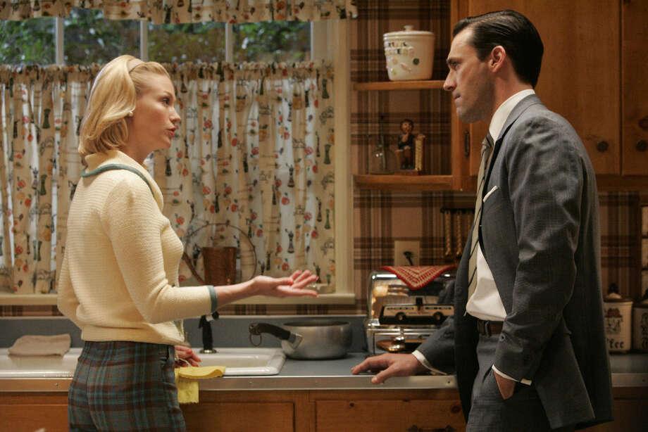 Don Draper (Jon Hamm) tries to figure out what\'s worrying his wife Betty Draper (January Jones).