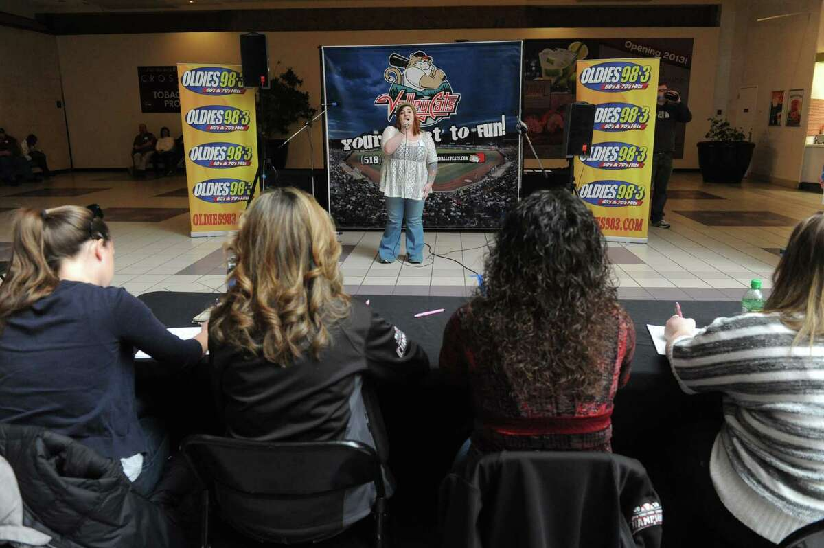 Lauren Kerr of Waterford competes in the 3rd Annual National Anthem tryouts hosted by Jaime Roberts from the Jaime in the Morning Show on Oldies 98.3, and Sammy Baseball from the ValleyCats at Crossgates Mall on Saturday April 6, 2013 in Guilderland, N.Y. The judging panel will select four finalists who will be videotaped singing their version of the National Anthem, and then be placed online for fans to vote on a winner. (Michael P. Farrell/Times Union)