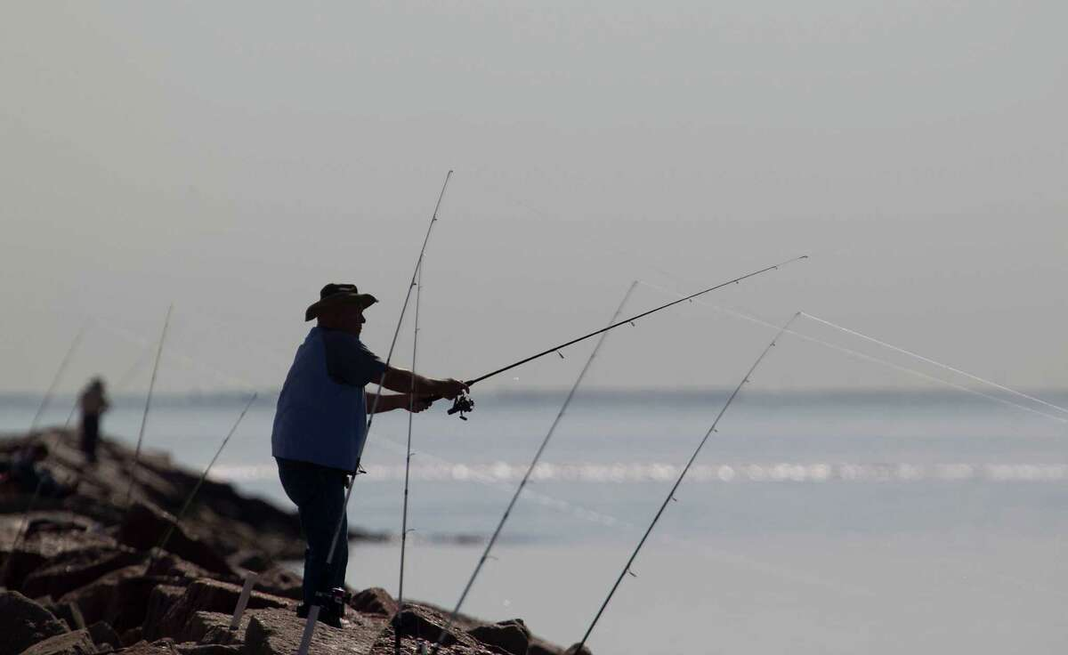 A man fishing on the Texas City Dike Wednesday, Feb. 27, 2013, in Texas City. ( James Nielsen / Houston Chronicle )