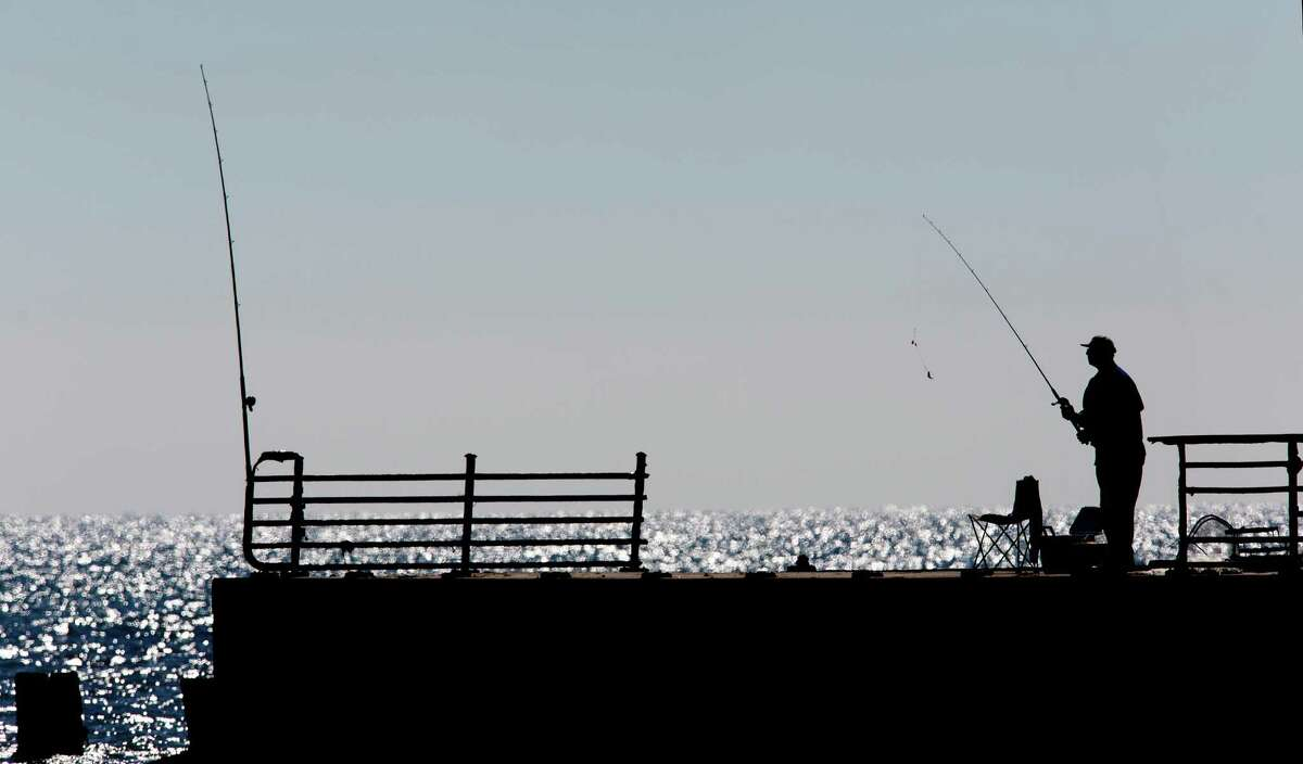 A fisherman gets ready to cast his bait at Rollover Pass on the Bolivar Peninsula.