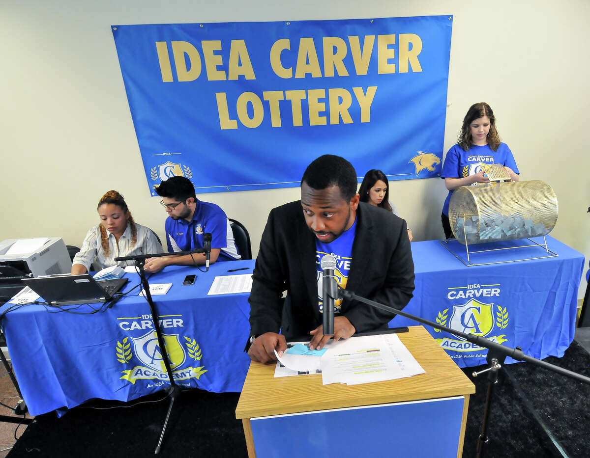 Mackee Mason, principal of IDEA Carver school, reads off winning names during a lottery for kindergarten admission to the school Saturday morning, April 6, 2013. Assisting him are (from left) Jennifer King George, Rick Cantu, Alisa Luna and Emily Fernandez.