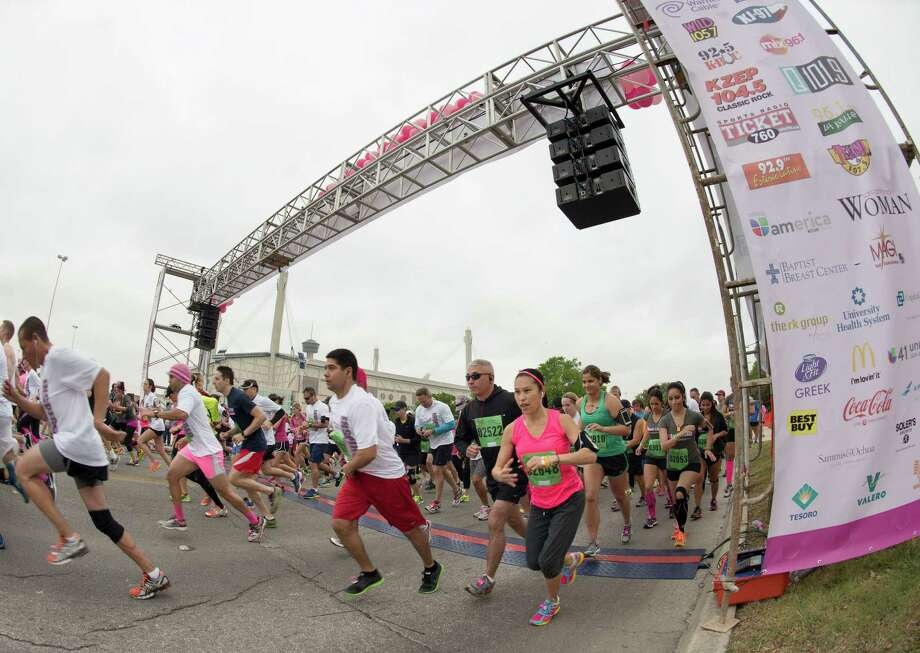 Participants leave the starting line during the Susan G. Komen Race for the Cure, Saturday, April 6, 2013, in San Antonio. (Darren Abate/For the Express-News) Photo: Darren Abate, Darren Abate/Express-News