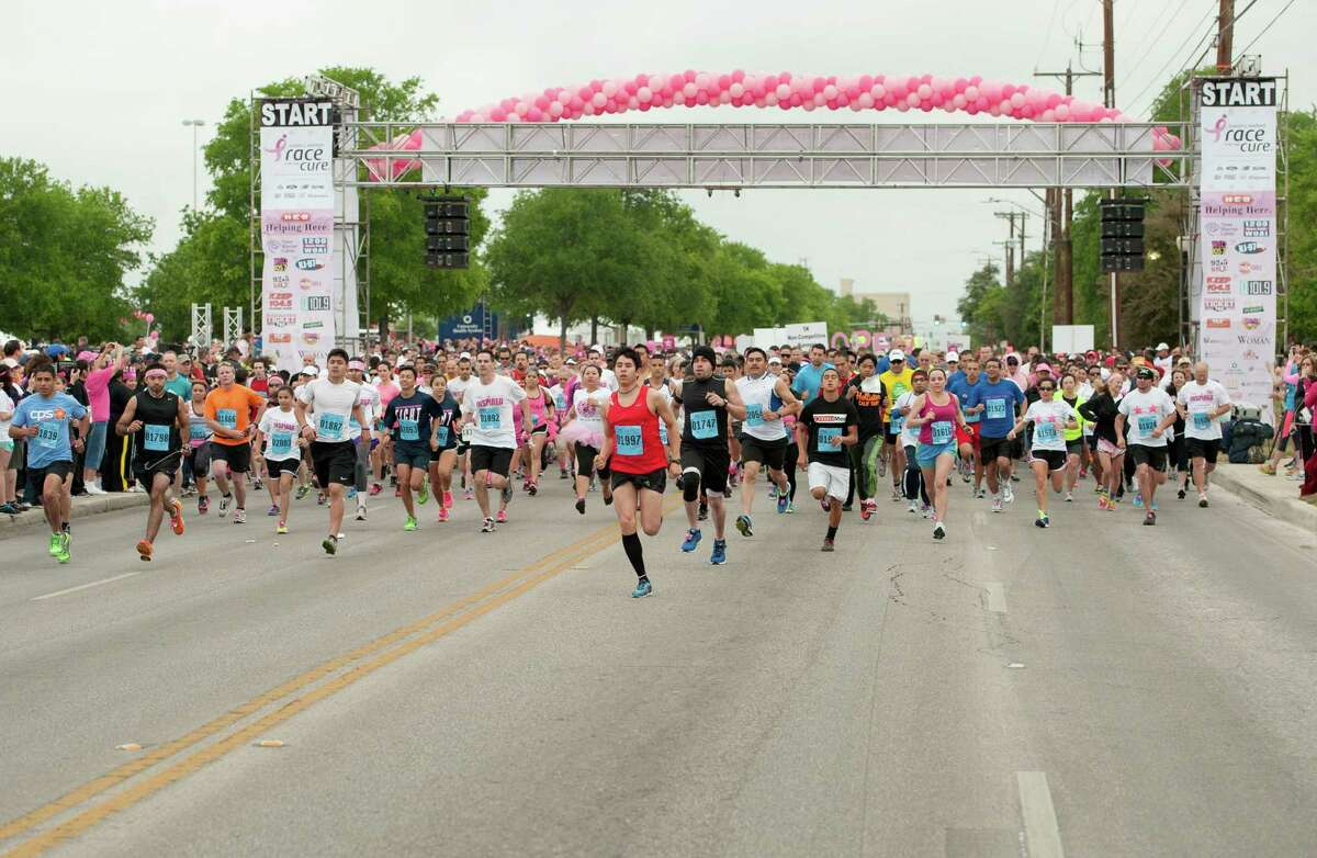 Participants leave the starting line during the Susan G. Komen Race for the Cure, Saturday, April 6, 2013, in San Antonio. (Darren Abate/For the Express-News)
