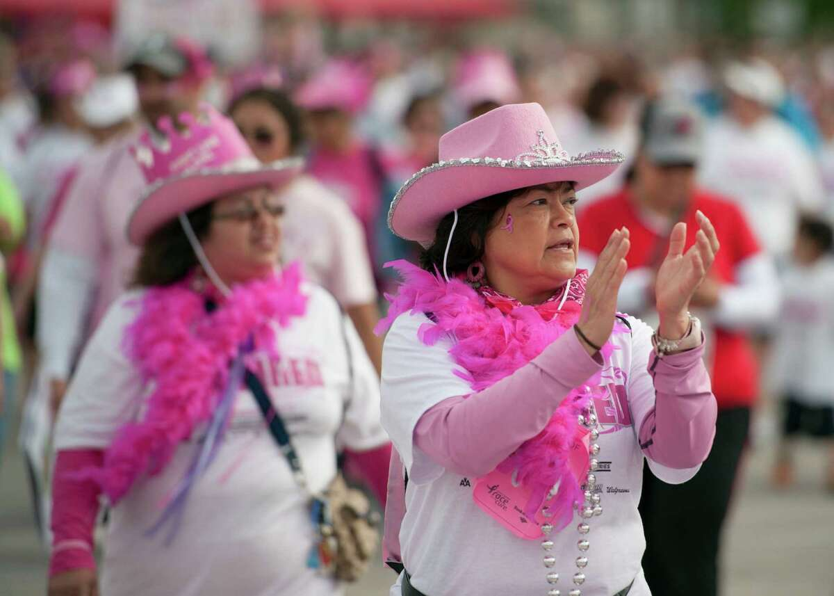 Participants cross the finish line during the Susan G. Komen Race for the Cure, Saturday, April 6, 2013, in San Antonio. (Darren Abate/For the Express-News)