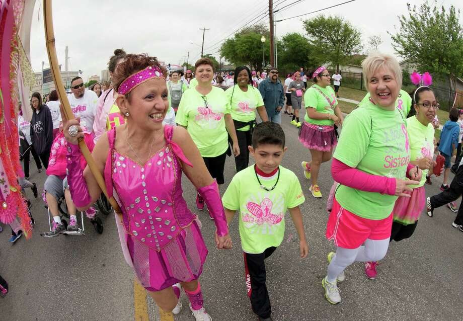 Three-time cancer survivor Julie Louviere (from left), is joint by her great nephew Dos Lafuente, 8, sister Alma Saenz, and daughter Ava Louviere during the Susan G. Komen Race for the Cure, Saturday, April 6, 2013, in San Antonio. (Darren Abate/For the Express-News) Photo: Darren Abate, Darren Abate/Express-News