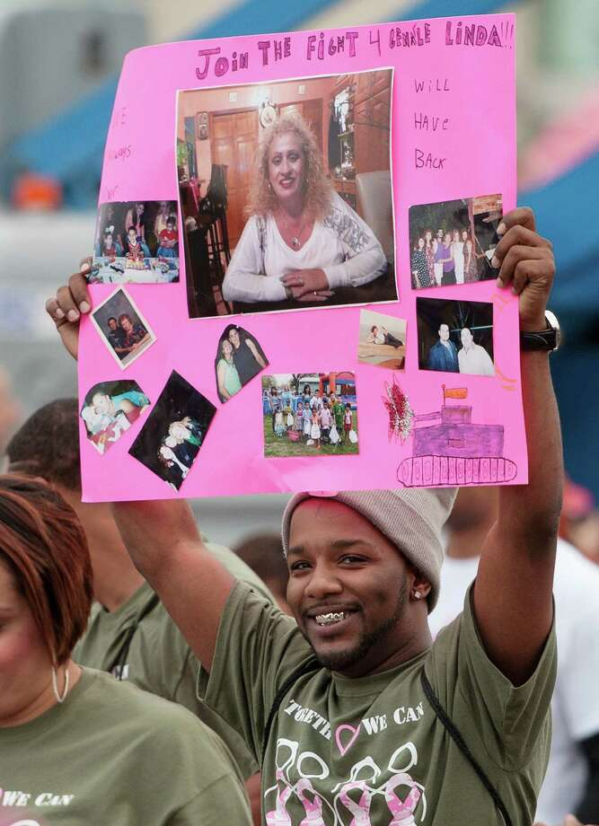 A participant holds up a sign in honor of loved-ones during the Susan G. Komen Race for the Cure, Saturday, April 6, 2013, in San Antonio. (Darren Abate/For the Express-News) Photo: Darren Abate, Darren Abate/Express-News
