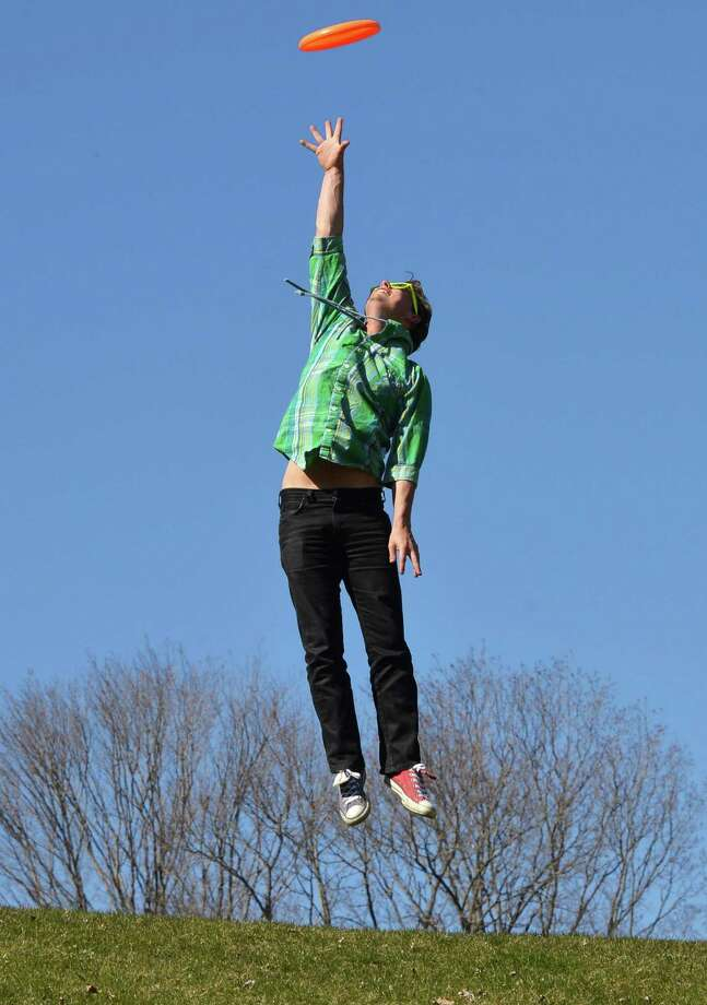 RPI exchange student Mikkel Jensen of Denmark jumps to catch a frisbee at Prospect Park in Troy, NY Saturday April 6, 2013.   (John Carl D'Annibale / Times Union) Photo: John Carl D'Annibale