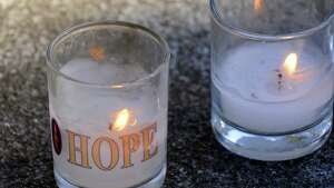 Memorial candles defy the wind during a ceremony for the 12th annual New York State Missing Persons Day on Saturday April 6, 2013 in Albany, N.Y. (Michael P. Farrell/Times Union)