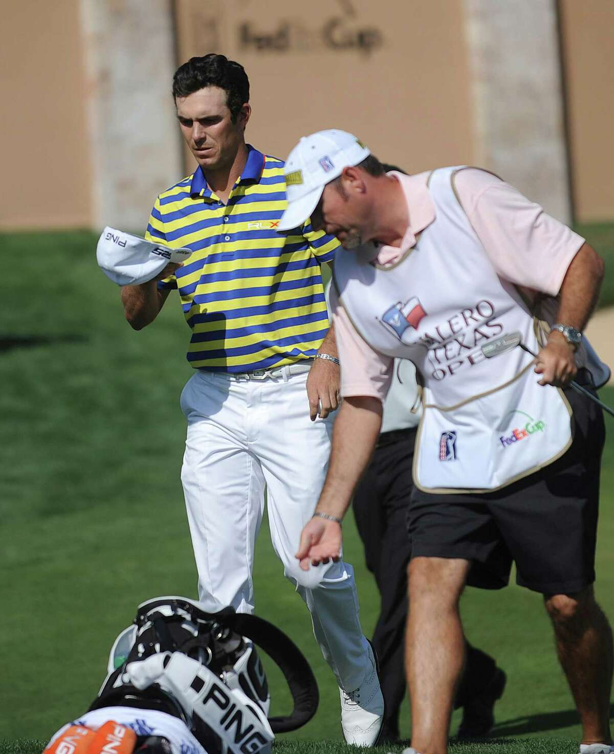 Billy Horschel leaves the course after going to 10 under par after three rounds of the Valero Texas Open at TPC San Antonio's AT&T Oaks Course on Saturday, April 6, 2013.
