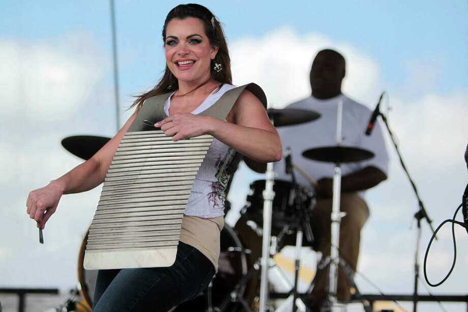 Alyssa Vincent plays the washboard with the Bon Ton Mickey, a Zydeco band, during the Pearland Crawfish Festival on Saturday, April 6, 2013, in Pearland. Photo: Mayra Beltran, Houston Chronicle / © 2013 Houston Chronicle