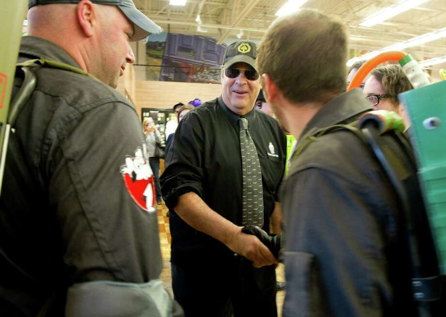 Dan Aykroyd meets men dressed as Ghostbusters during a bottle signing event at Total Wine & More in Norwalk on Saturday, April 6, 2013. Photo: Lindsay Perry / Stamford Advocate