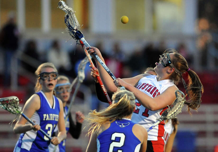 Fairfield Warde's  during girls lacrosse action against Fairfield Ludlowe in Fairfield, Conn. on Friday April 5, 2013. Photo: Christian Abraham / Connecticut Post