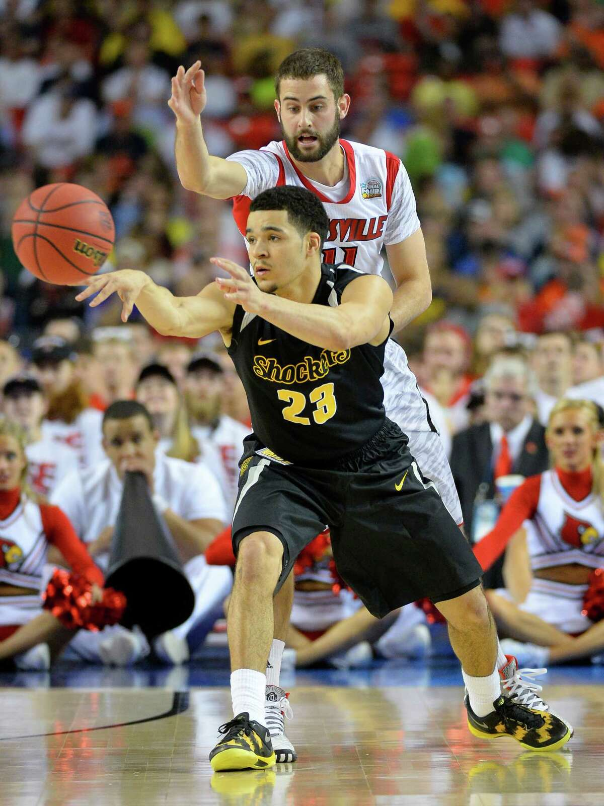 Road to Atlanta: Look back at the full March Badness bracket Live Updates: Follow all the Final Four action Wichita State guard Fred VanVleet (23) passes the ball in front of the defense of Luke Hancock (11) of the Louisville Cardinals in the first half of a semi-final matchup in the NCAA Men's Basketball Championship at the Georgia Dome in Atlanta, Georgia, Saturday, April 6, 2013.