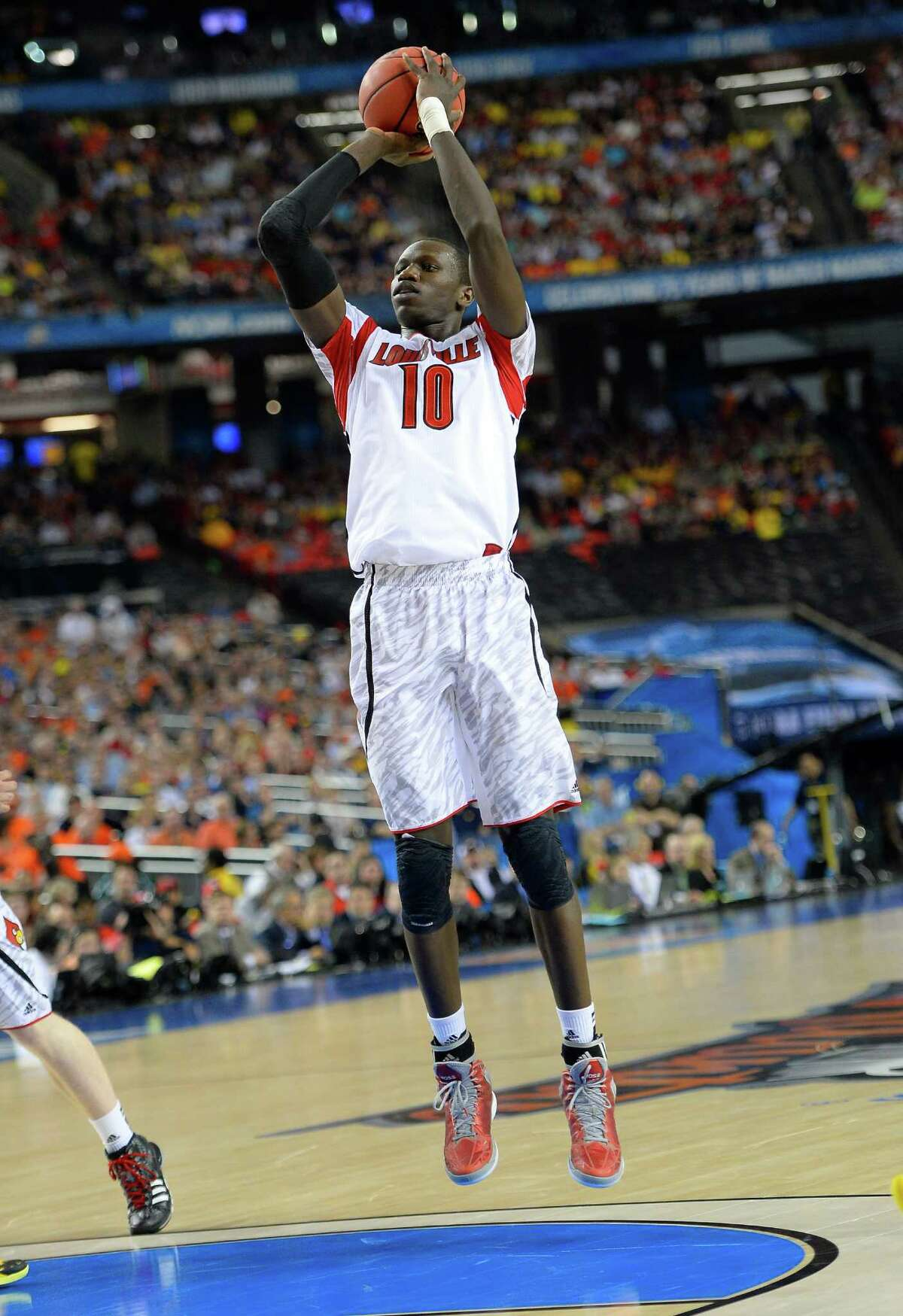 Road to Atlanta: Look back at the full March Badness bracket Live Updates: Follow all the Final Four action Louisville center Gorgui Dieng (10) takes a shot against Wichita State in the first half.