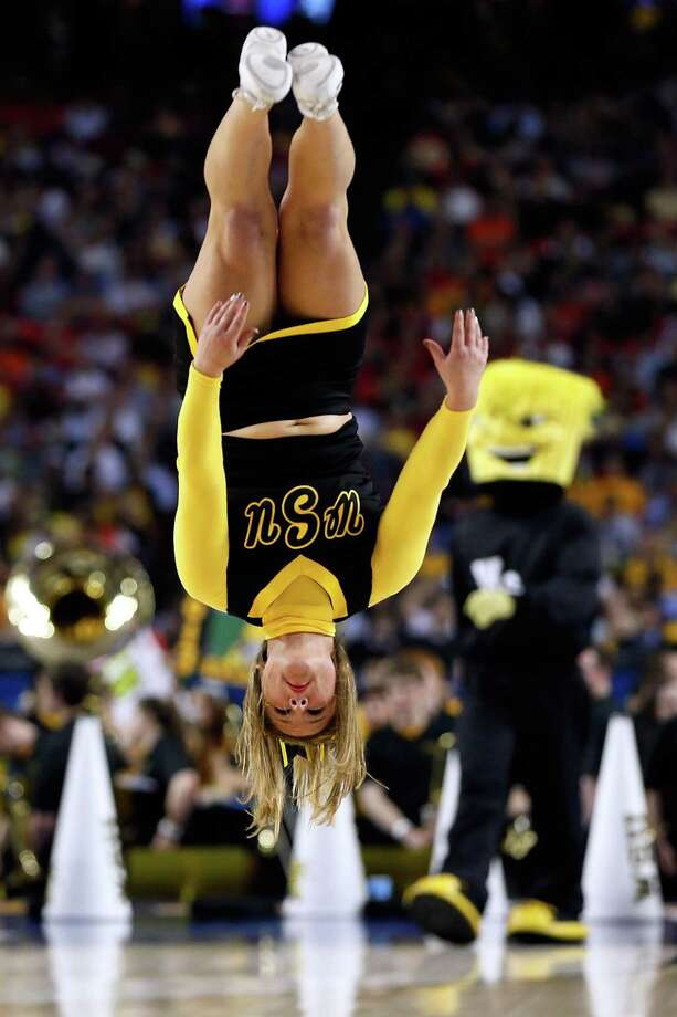 Road to Atlanta: Look back at the full March Badness bracketLive Updates: Follow all the Final Four actionA Wichita State Shockers cheerleader flips during a break in the game against the Louisville Cardinals in the 2013 NCAA Men's Final Four Semifinal at the Georgia Dome. Photo: Kevin C. Cox, Getty Images / 2013 Getty Images