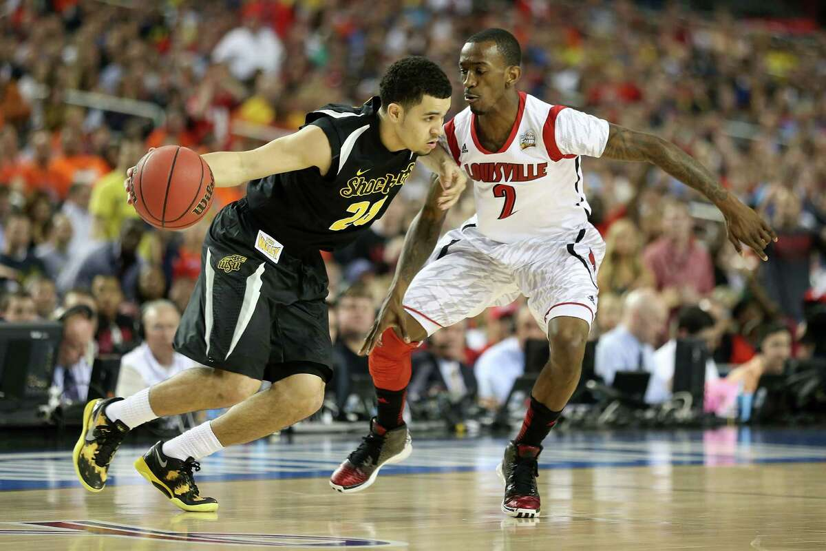 ATLANTA, GA - APRIL 06: Fred VanVleet #23 of the Wichita State Shockers drives the ball in the first half against Russ Smith #2 of the Louisville Cardinals during the 2013 NCAA Men's Final Four Semifinal at the Georgia Dome on April 6, 2013 in Atlanta, Georgia.