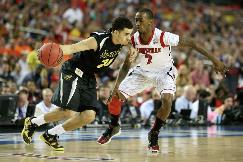 ATLANTA, GA - APRIL 06:  Fred VanVleet #23 of the Wichita State Shockers drives the ball in the first half against Russ Smith #2 of the Louisville Cardinals during the 2013 NCAA Men's Final Four Semifinal at the Georgia Dome on April 6, 2013 in Atlanta, Georgia. Photo: Andy Lyons, Getty Images / 2013 Getty Images