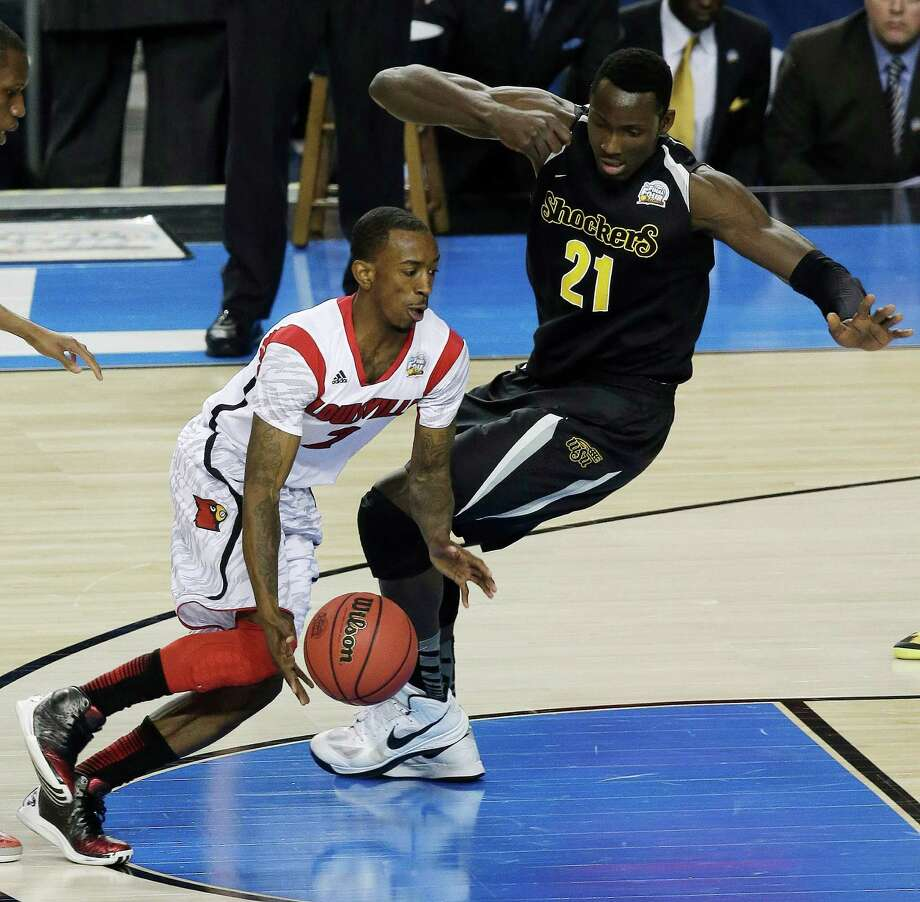 Louisville's Russ Smith (2) works against Wichita State's Ehimen Orukpe (21) during the first half of the NCAA Final Four tournament college basketball semifinal game Saturday, April 6, 2013, in Atlanta. (AP Photo/Chris O'Meara) Photo: Chris O'Meara, Associated Press / AP