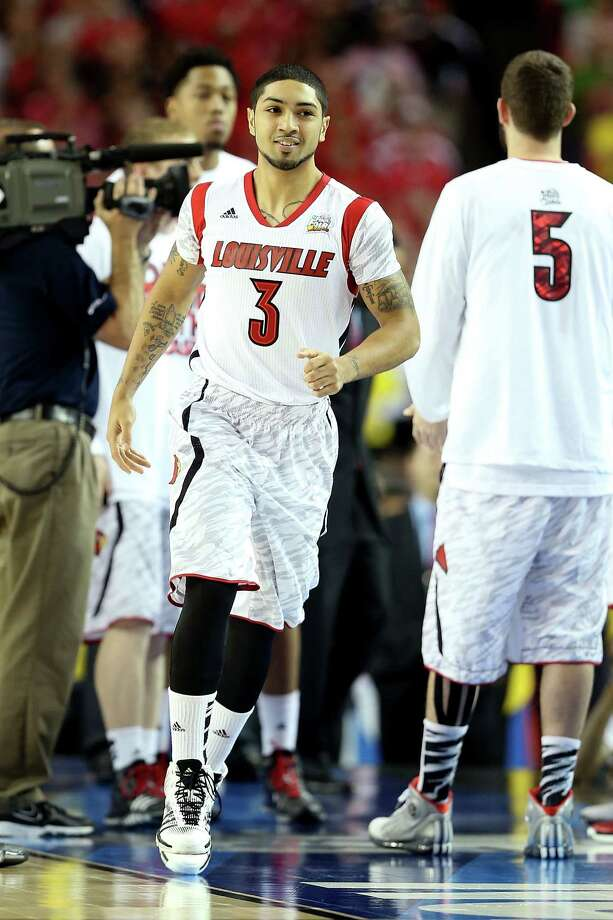 ATLANTA, GA - APRIL 06:  Peyton Siva #3 of the Louisville Cardinals runs on the court during player introductions against the Wichita State Shockers during the 2013 NCAA Men's Final Four Semifinal at the Georgia Dome on April 6, 2013 in Atlanta, Georgia. Photo: Andy Lyons, Getty Images / 2013 Getty Images