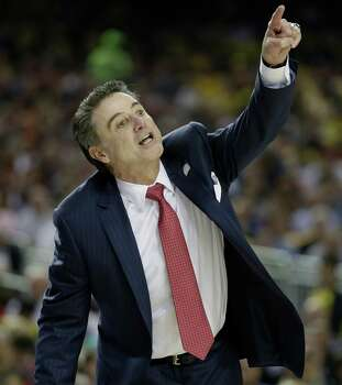 Louisville head coach Rick Pitino speaks to players during the first half of the NCAA Final Four tournament college basketball semifinal game against Wichita State, Saturday, April 6, 2013, in Atlanta. (AP Photo/David J. Phillip) Photo: David J. Phillip, Associated Press / AP