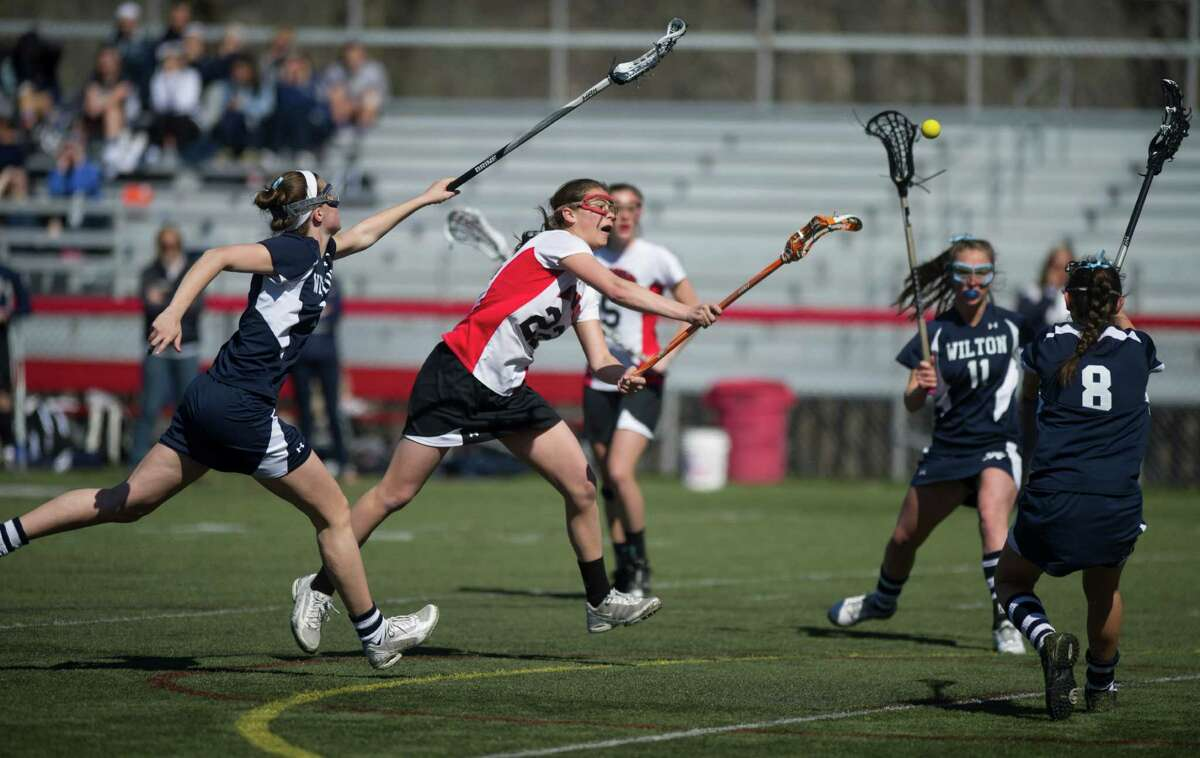 New Canaan's Olivia Hompe takes a shot during Saturday's girl's lacrosse game against Wilton at New Canaan High School on April 6, 2013.