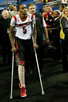 ATLANTA, GA - APRIL 06:  Injured Louisville Cardinals player Kevin Ware #5 heads to the bench before the Cardinals take on the Wichita State Shockers in the 2013 NCAA Men's Final Four Semifinal at the Georgia Dome on April 6, 2013 in Atlanta, Georgia. Photo: Kevin C. Cox, Getty Images / 2013 Getty Images
