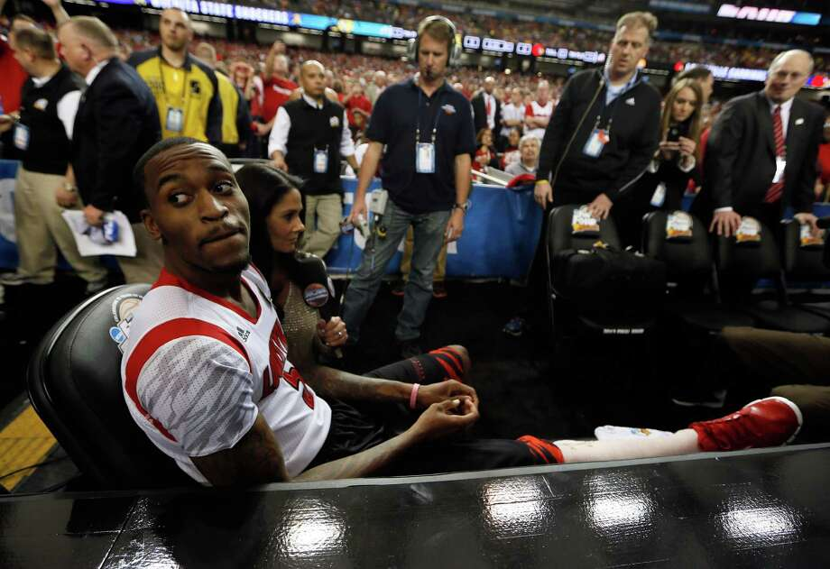ATLANTA, GA - APRIL 06:  Injured Louisville Cardinals player Kevin Ware #5 sits on the bench as he waits to be interviewed by CBS Sports reporter Tracy Wolfson before the Cardinals take on the Wichita State Shockers in the 2013 NCAA Men's Final Four Semifinal at the Georgia Dome on April 6, 2013 in Atlanta, Georgia. Photo: Kevin C. Cox, Getty Images / 2013 Getty Images