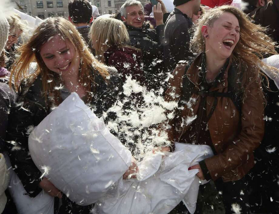 Revellers take part in a giant pillow fight in Trafalgar Square on 'International Pillow Fight Day' on April 6, 2013 in London, England. Mass public pillow fights have been arranged in numerous cities around the world as part of the 'Urban Playground Movement' which facilitates free, public non-commercial events. Photo: Oli Scarff, Getty Images / 2013 Getty Images