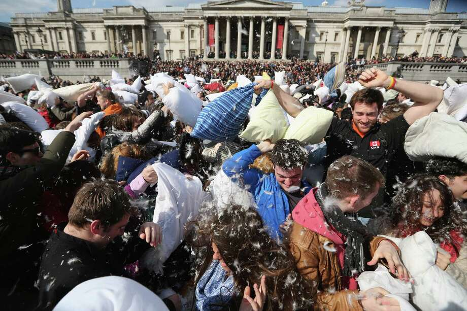 Revellers take part in a giant pillow fight in Trafalgar Square on 'International Pillow Fight Day' on April 6, 2013 in London, England. Photo: Oli Scarff, Getty Images / 2013 Getty Images