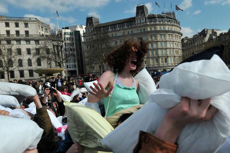 Revellers take part in a mass pillow fight in Trafalgar Square in central London on April 6, 2013 on International Pillow Fight Day. Photo: CARL COURT, AFP/Getty Images / AFP