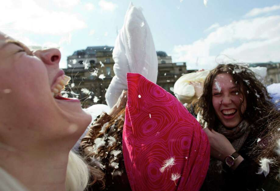 People take part in a pillow fight in Trafalgar Square in London, Saturday, April 6, 2013. Photo: Matt Dunham, Associated Press / AP