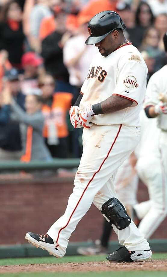 The Giants' Pablo Sandoval crosses home plate after a solo homer in the eighth. Photo: Mathew Sumner, Special To The Chronicle
