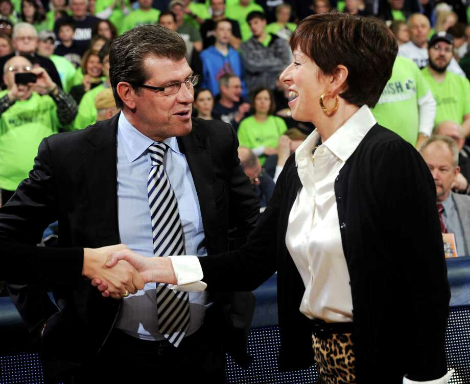 Connecticut coach Geno Auriemma and Notre Dame coach Muffet McGraw have been crossing paths for decades, and they meet again Sunday night in a national semifinal game at New Orleans. Photo: Joe Raymond, FRE / FR25092 AP