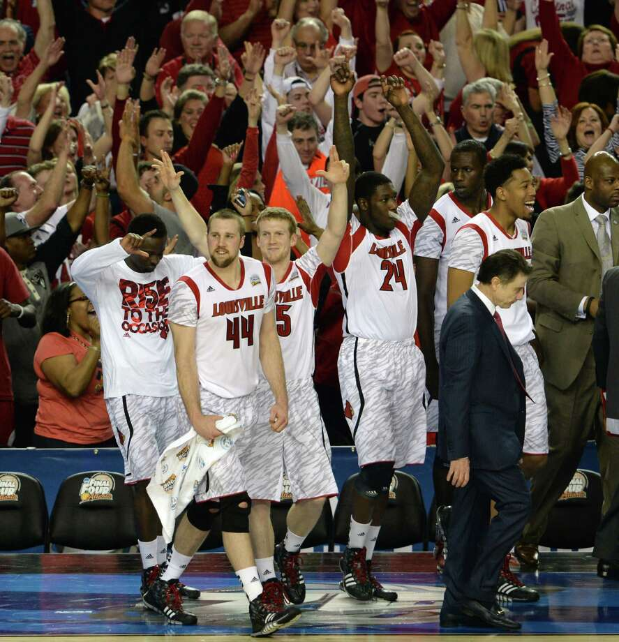 The Louisville bench celebrates as time runs out in a 72-68 victory against Wichita State in a semi-final matchup in the NCAA Men's Basketball Championship at the Georgia Dome in Atlanta, Georgia, Saturday, April 6, 2013. (Harry E. Walker/MCT) Photo: Harry E. Walker, McClatchy-Tribune News Service / MCT