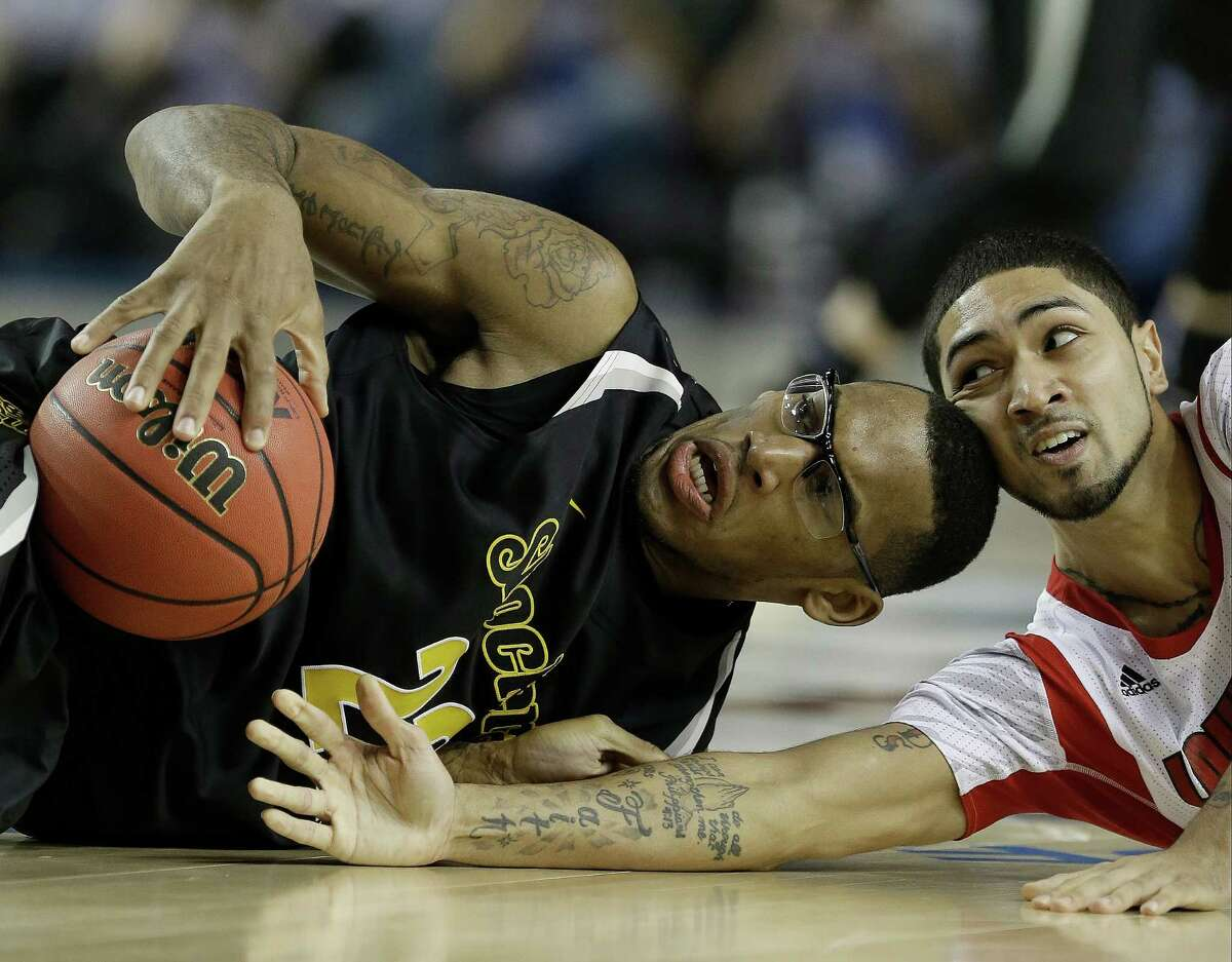 Wichita State's Carl Hall (22) and Louisville's Russ Smith (2) vie for a loose ball during the second half of the NCAA Final Four tournament college basketball semifinal game Saturday, April 6, 2013, in Atlanta. (AP Photo/Charlie Neibergall)