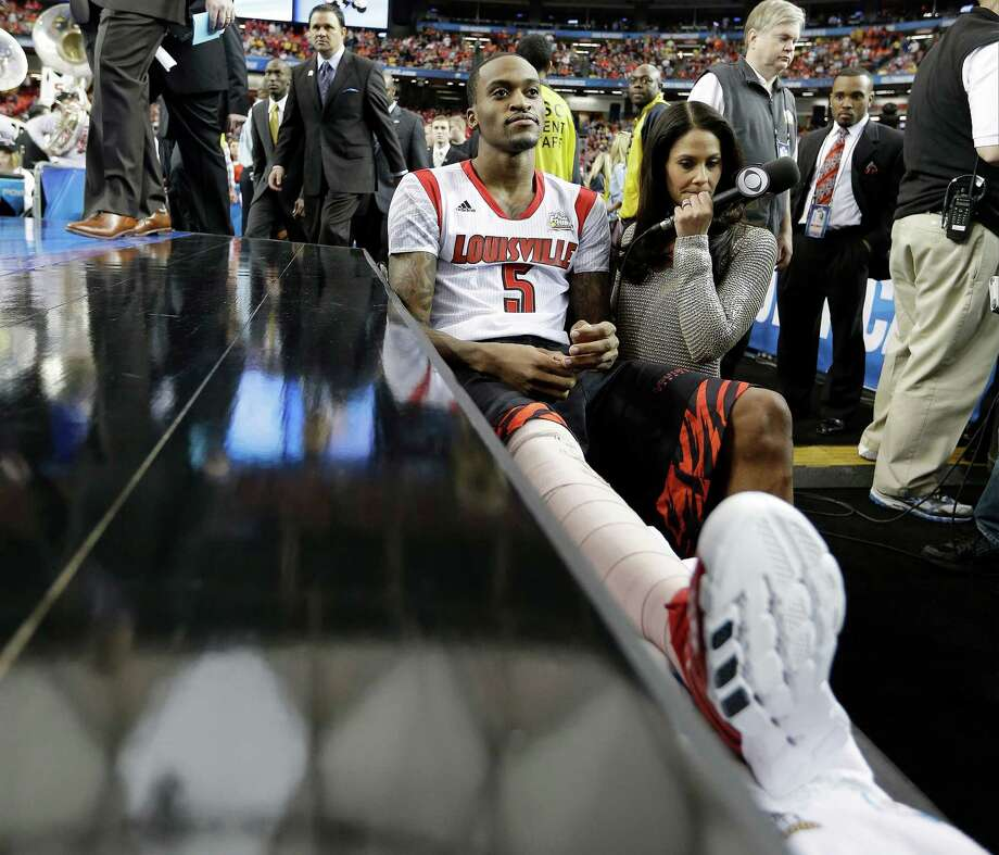 Louisville's Kevin Ware sits on the bench at the court before the first half of the NCAA Final Four tournament college basketball semifinal game against Wichita State, Saturday, April 6, 2013, in Atlanta. (AP Photo/David J. Phillip) Photo: David J. Phillip, STF / AP