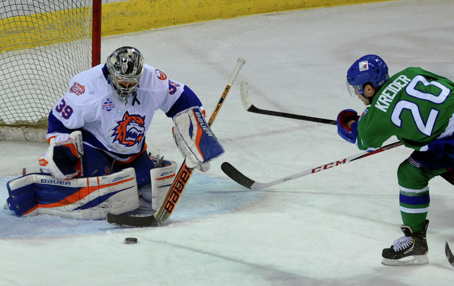 Connecticut Whale's #20 Chris Kreider tries to send a shot past Sound Tigers goalie Rick DiPietro, during AHL hockey action at the Webster Bank Arena in Bridgeport, Conn. on Saturday April 6, 2013. Photo: Christian Abraham / Connecticut Post