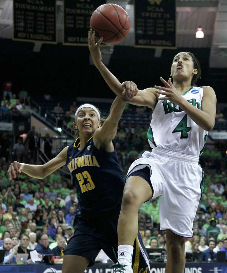 California guard Layshia Clarendon (23) fouls Notre Dame guard Skylar Diggins during the second half of a second-round NCAA women's tournament basketball game in South Bend, Ind., Tuesday, March 20, 2012. Notre Dame won 73-62. Photo: Charles Rex Arbogast, Associated Press / AP