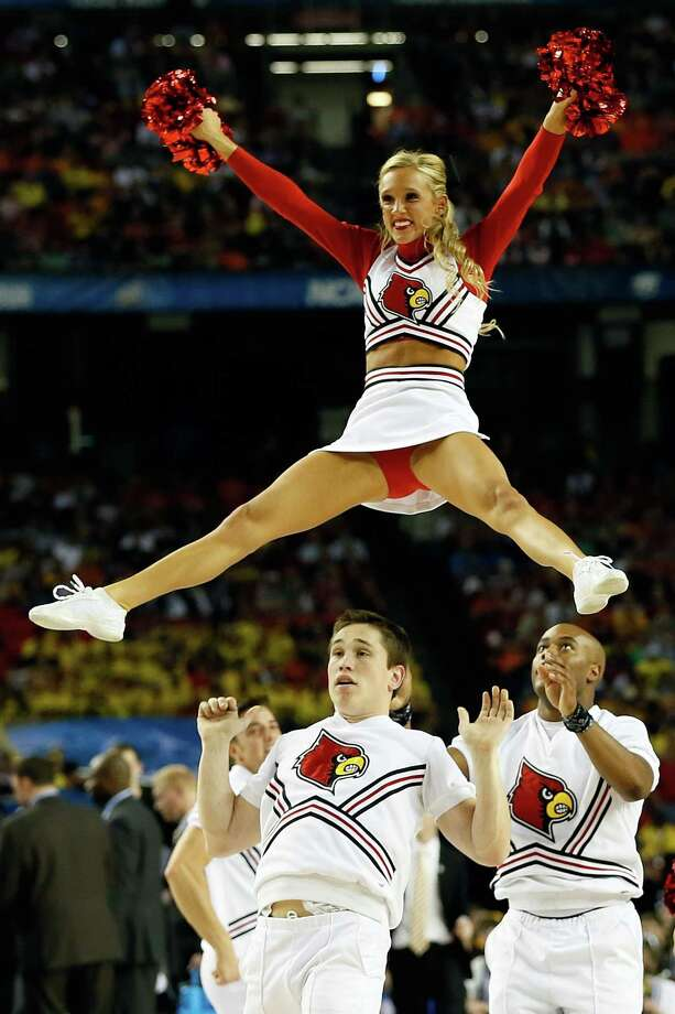 ATLANTA, GA - APRIL 06:  Cheerleaders for the Louisville Cardinals perform in the second half against the Wichita State Shockers during the 2013 NCAA Men's Final Four Semifinal at the Georgia Dome on April 6, 2013 in Atlanta, Georgia. Photo: Kevin C. Cox, Getty Images / 2013 Getty Images
