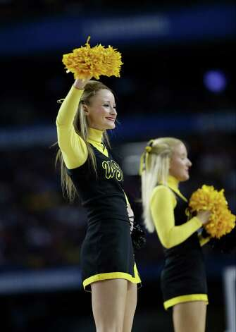 Wichita State cheerleaders during the second half of the NCAA Final Four tournament college basketball semifinal game against Louisville Saturday, April 6, 2013, in Atlanta. (AP Photo/John Bazemore) Photo: John Bazemore, Associated Press / AP