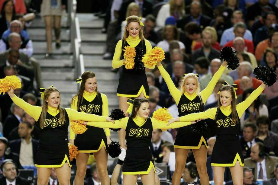 Wichita State cheerleaders cheer during the second half of the NCAA Final Four tournament college basketball semifinal game against Louisville Saturday, April 6, 2013, in Atlanta. (AP Photo/Chris O'Meara) Photo: Chris O'Meara, Associated Press / AP